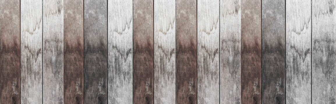 Panorama of Old brown white wooden fence with stains texture and background seamless