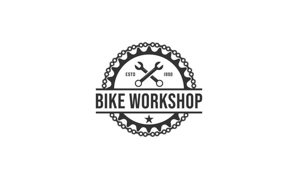 logo for bicycle repair shop with illustration of bicycle gear and repair tools