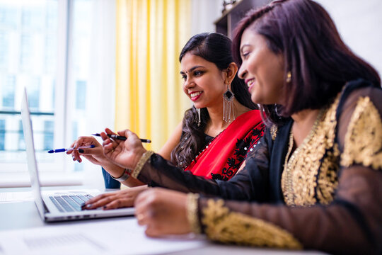 two beautiful women in tradition sari working at office or cafe