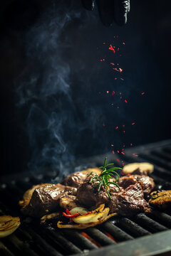 pieces of beef steaks from grill. concept cooking meat with smoke, spices and rosemary. Barbecue and cooking