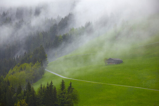 South Tyrol impressions with a mountain hut in the fog.