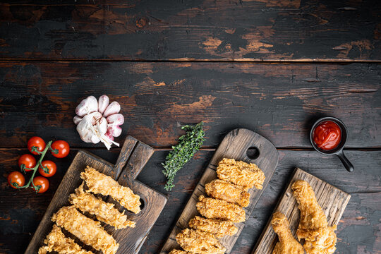 Southern fried chicken on dark wooden background, top view, with space for text