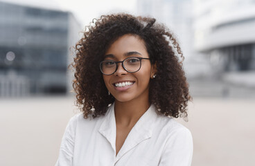 Fototapeta Young beautiful woman portrait, African student girl in a city, Young businesswoman smiling outdoor, People, enjoy life, student lifestyle, city life, business concept obraz