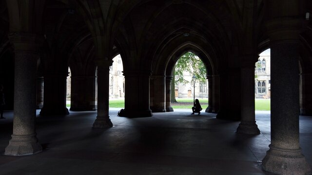 The Cloisters at Glasgow University looking out onto a quadrangle.