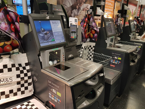 Brighton, England-18 October,2018: Sef-service counter machine in Mark and Spencer for customer with the touchscreen display and barcode scanner.