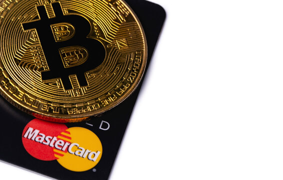 bitcoin cryptocurrency and MasterCard card. MasterCard worldwide is an American multinational financial services corporation. Moscow, Russia - August 16, 2020