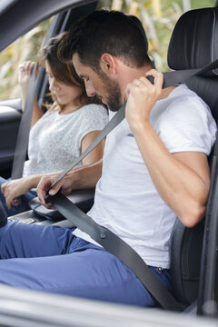 woman and man in the car wear a seat belt