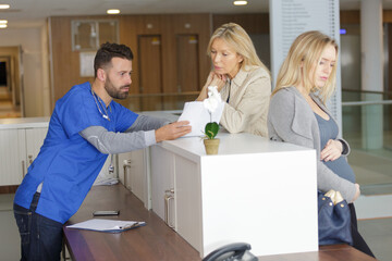 pregnant woman on reception at the doctors