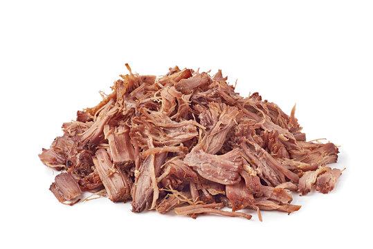 Heap of shredded beef on white