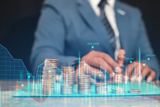 A businessman or trader displays a FOREX chart hologram to analyze market behavior.