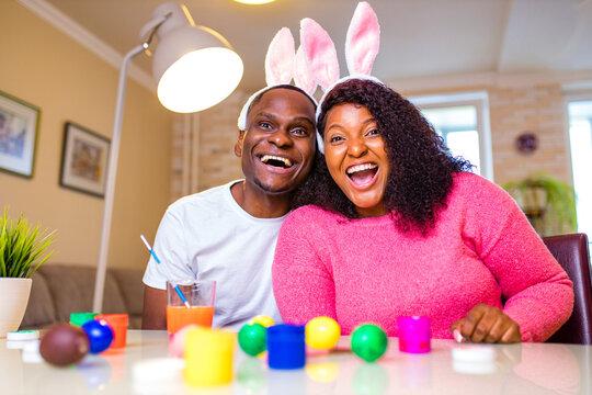 african american man preparing for Easter in apartment
