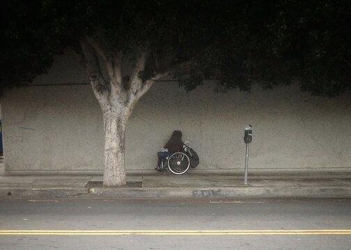 Person On Wheelchair At Sidewalk