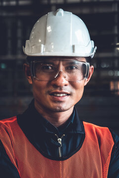 Young factory job worker or engineer close up portrait in manufacturing factory . Industry and engineering concept .