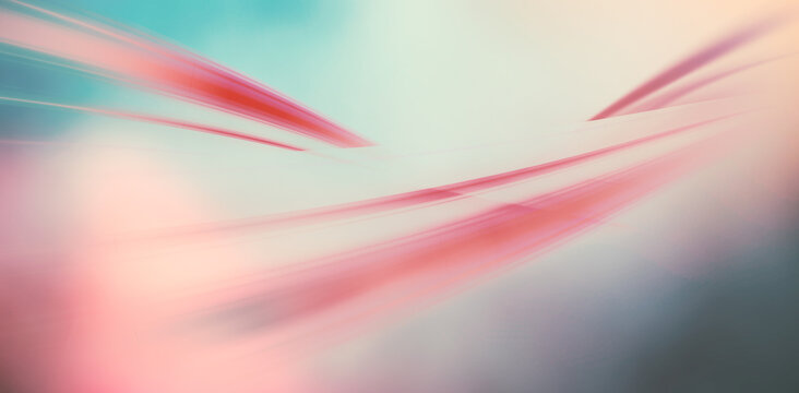 Abstract illustration of pink light trails lines against grey and green gradient background