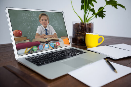 Caucasian schoolboy learning displayed on laptop screen during video call