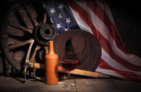 Wooden oak barrel and american flag on rustic background. USA holidays .
