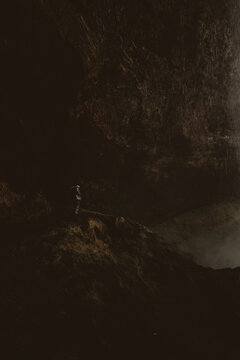 Man standing on rock in cave