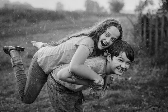 Happy children playing in the rain.