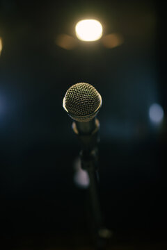 Old microphone on stage closeup.