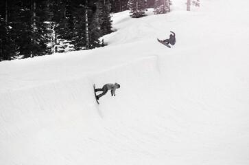 snowboarders on half pipe in California