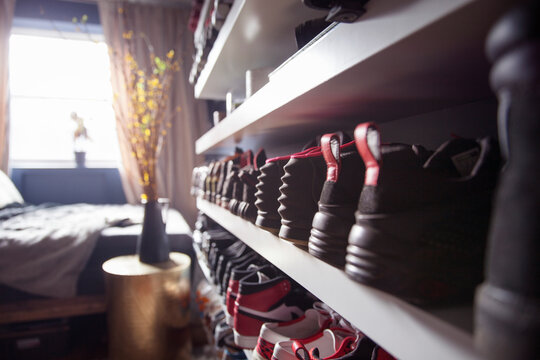 Close-up of shoes arranged in shelf at home