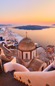 Fira town on the coast of Santorini island by the sea at dusk