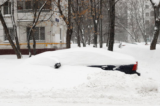 Moscow, Russia. 13th February 2021. A blizzard covered the city. A car is completely covered under the snow.