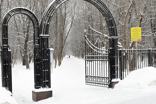 Moscow, Russia. 13th February 2021. A blizzard covered the city. Entrance gate of Terletskiy park in Moscow