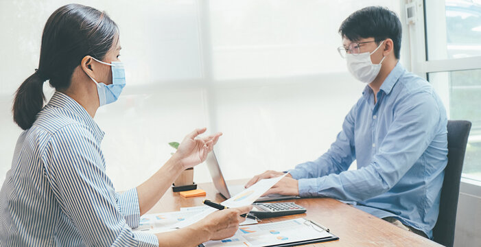 Asian People Successful Teamwork Business Wearing Medical Mask and Working. Work from Private Office Social Distancing among Coronavirus Outbreak Situation