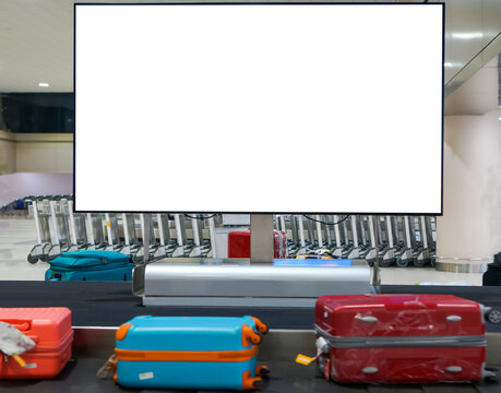 Airport banner for Advertising mock up empty, Blank billboard at conveyor belt luggage in trolley with screen for cutomer text information advertise about tourism transport business