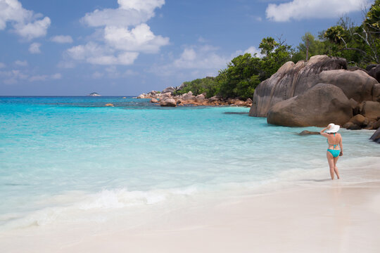 A white sand beach with turqouise water and stones