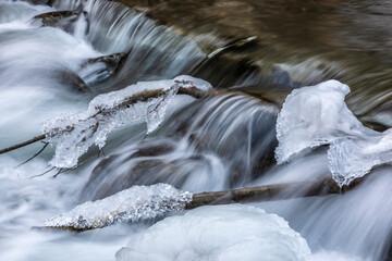 cascades in river raab in winter, austria Wall mural