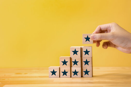 Award,review feedback,or result concepts with star on wood step.business development.