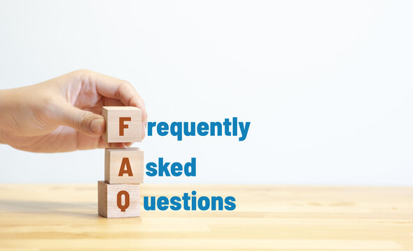 FAQ ,frequently asked questions concepts with text on wood.education and development.