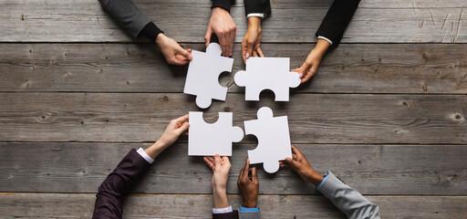 Fototapeta Business teamwork with puzzle obraz