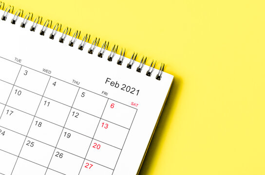 Close up February 2021 Calendar desk for organizer to plan and reminder.