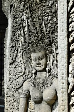 Close-up of a carving of an apsara or dancing female divinity on the outer wall of Angkor Wat in Cambodia