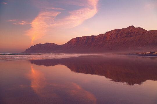 Cliffs of Caleta de Famara Beach at sunset, Lanzarote, Canary Islands, Spain.