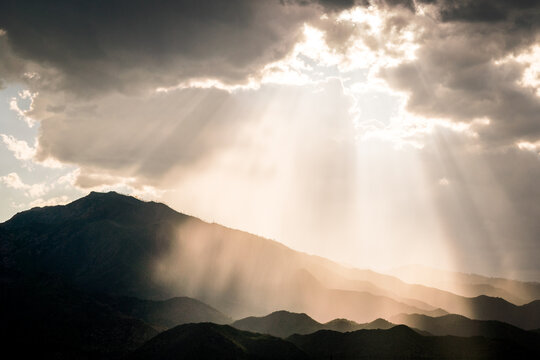 Sun Rays and Beams Reflected on Mountain Layers
