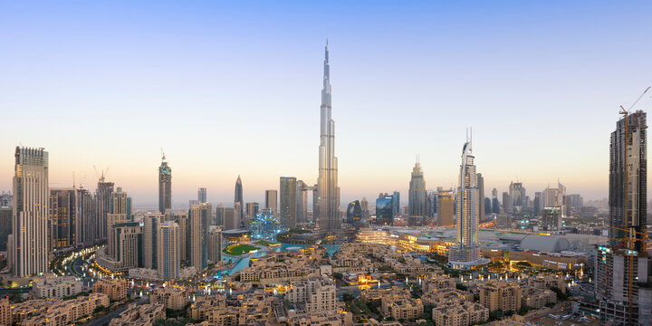 Panoramic view of Dubai skyline and Burj Khalifa under golden light