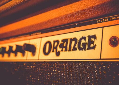 Orange electric guitar amplifier close-up view