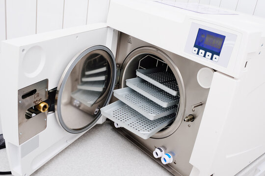 Medical autoclave close-up without tools. A sterilizer that processes tools using steam, which is supplied under pressure.