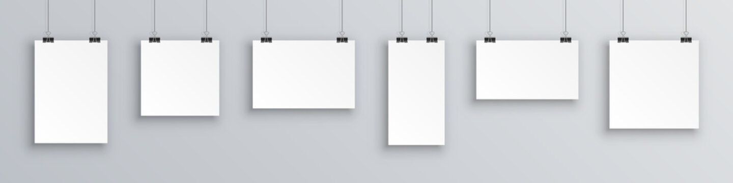 Mock up hanging empty white paper blank. Concept gallery portfolio, photo frame paper, poster. Creative of blank posters hanging list with shadows. Hanging white paper on binders, sheet on wall