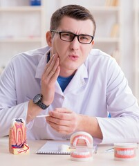 Dentist working teeth implant in medical lab