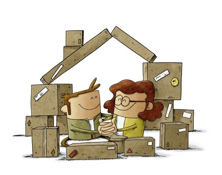 A couple in love are among some cardboard boxes that form the shape of a house. home buying concept. isolated