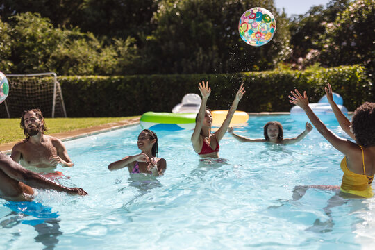 Diverse group of friends having fun in swimming pool