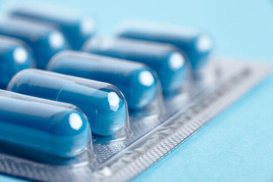 Blister pack of blue medicine pills.