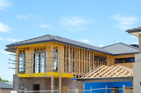 The structure of a two-story residential suburban house under construction. Concept of real estate development, self build a home, new Australian suburb, and homeownership. Melbourne, VIC Australia.