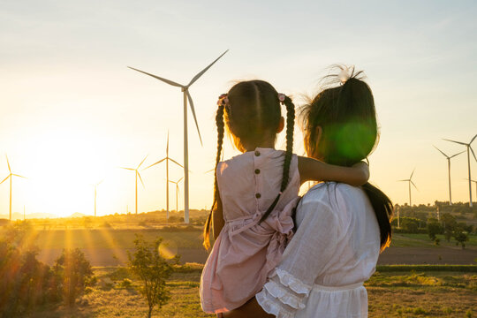Wind turbines are alternative electricity sources, the concept of sustainable resources, People in the community with wind generators turbines, Renewable energy