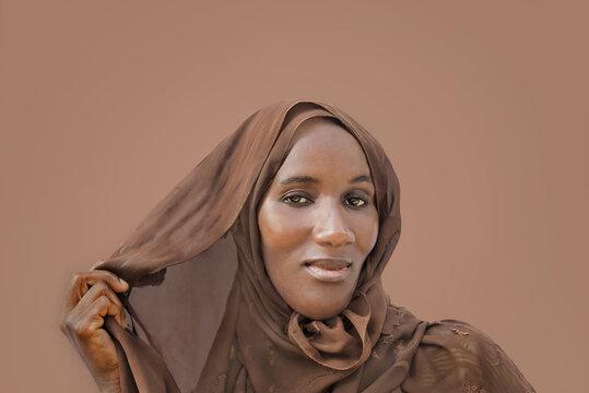 Woman wearing a brown headscarf, photo